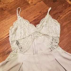 Grey lace romper with cut out detail